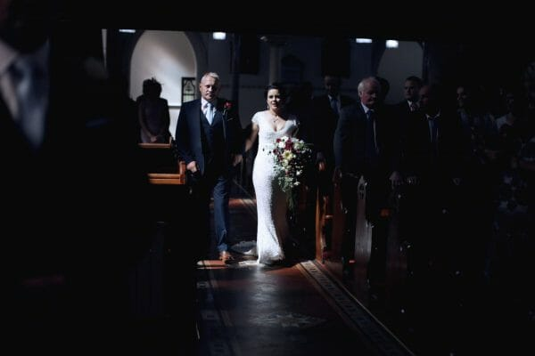 Father walking bride down the aisle at church