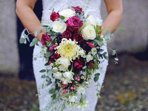 Bride holding her wedding flower bouquet